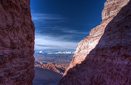 view of high desert through a mountain crevasse