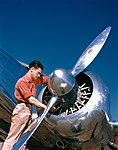 Aviation Mechanic with Lockheed 12A Electra Junior (8596149060).jpg