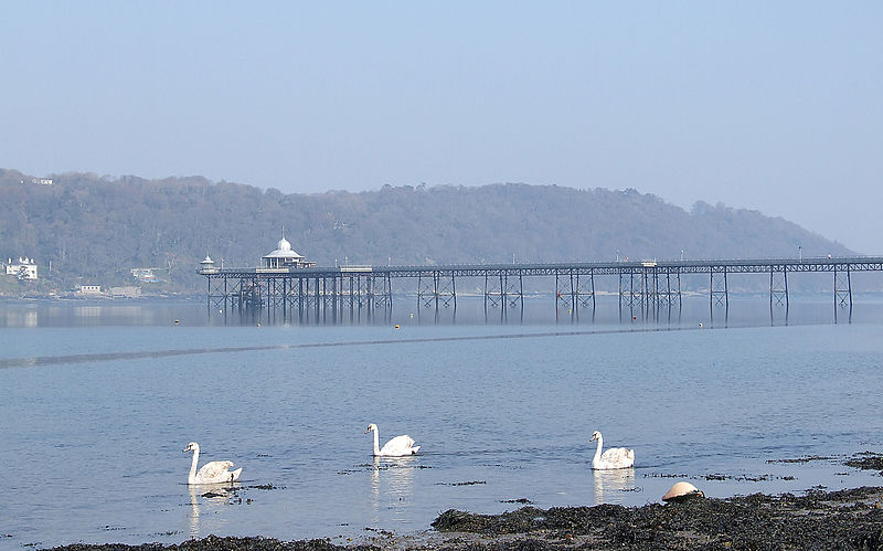 Bangor pier with swans on the Menai Strait and the shores of Angelsey beyond