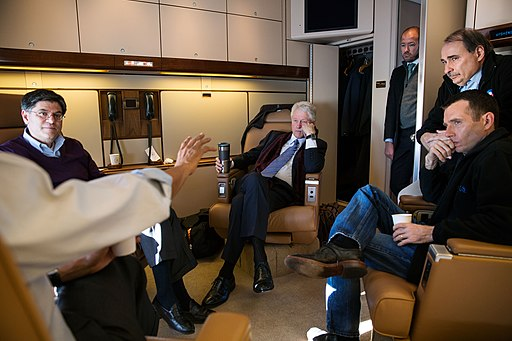 Barack Obama with Bill Clinton and others on Air Force One