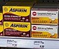 Bayer Aspirin and store-brand generic on Canadian drugstore shelf.jpg