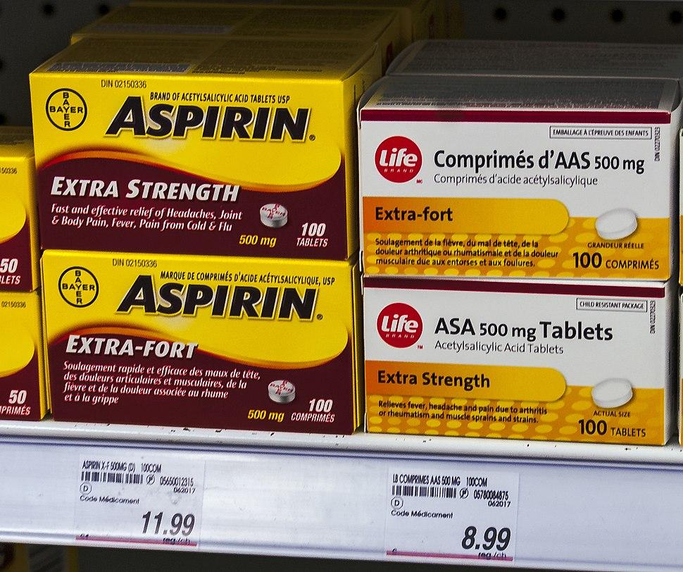 Bayer Aspirin and store-brand generic on Canadian drugstore shelf