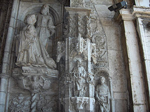 Nicolau Chanterene - The kneeling queen Maria of Aragon  western portal of the Jerónimos Monastery in Belém