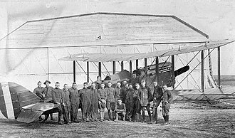 "Benbrook Field - Flying cadets pose in front of a Curtiss JN-4 ""Jenny"" at Benbrook Field"
