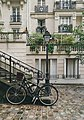 Bicycle with French buildings (Unsplash).jpg