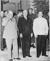 Biritsh Prime Minister Winston Churchill, President Harry S. Truman, and Soviet leader Josef Stalin pose in front of... - NARA - 198907.tif