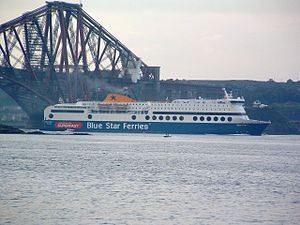 Rosyth - Blue Star 1 passing under the Forth Bridge in the Firth of Forth, en route from Rosyth to Zeebrugge.