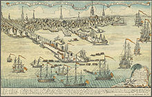 A wide view of a port town with several wharves. In the foreground there are eight large sailing ships and an assortment of smaller vessels. Soldiers are disembarking from small boats onto a long wharf, the skyline of the town, with nine tall spires and many smaller buildings, is in the distance. A key at the bottom of the drawing indicates some prominent landmarks and the names of the warships.