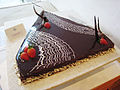 Boston cream pie with decorative design and strawberries.jpg