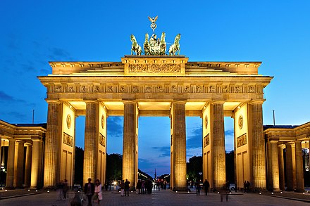 Brandenburg Gate in Berlin, national symbol of today's Germany and its reunification in 1990. Brandenburger Tor abends.jpg