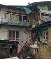 Broken Buddha Lodge at Chaurikharka Nepal after April 2015 Earthquake.jpg