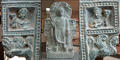 The Buddha, flanked by Herakles/ Vajrapani and Tyche/ Hariti.