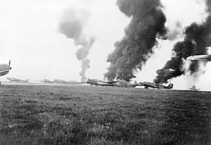 Battle of Rotterdam - Junkers Ju 52 transport aircraft burning at Rotterdam.