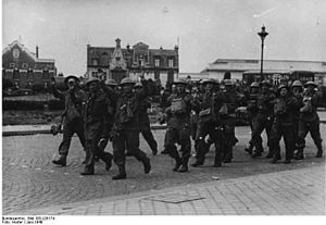 1st Searchlight Regiment, Royal Artillery - British prisoners being marched away after the fall of Calais, 26 May 1940