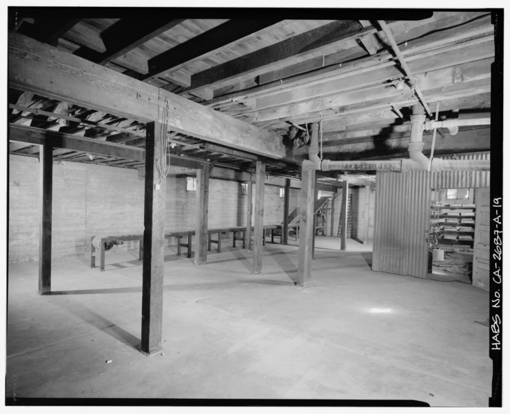 bunkhouse basement interior showing storage area and a conveyor belt