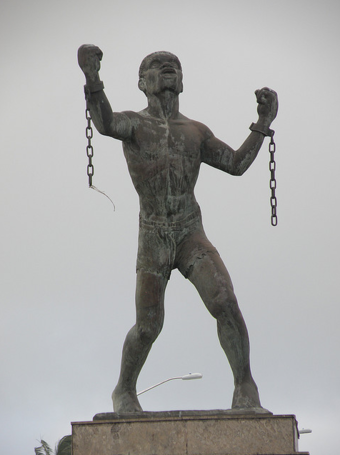 Statue of Bussa, who led the largest slave rebellion in Barbadian history. Bussa statue.png