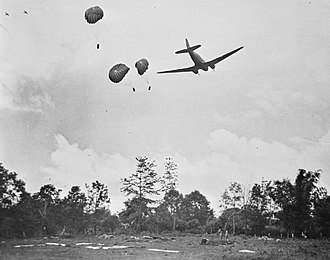 Burma Campaign 1944 - A C-47 transport aircraft drops supplies by parachute to Allied troops in action against Japanese forces; a common event during the fighting in Burma and India during 1944.