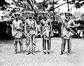 COLLECTIE TROPENMUSEUM Beambten van het hof van Bima in staatsiekleding Soembawa TMnr 10005881.jpg