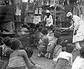 COLLECTIE TROPENMUSEUM Vrouwen en kinderen in gebed voor de offergaven Bali TMnr 10001196.jpg