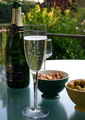 sparkling wine bottle and flute