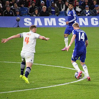 Matt Mills - Mills (left) playing for Bolton Wanderers against Chelsea in the League Cup, 2014