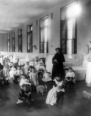Sister Irene of New York Foundling Hospital with children. Sister Irene is among the pioneers of modern adoption, establishing a system to board out children rather than institutionalize them. Children at New York Foundling cph.3a23917.jpg