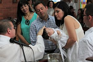 Infant baptism by effusion in a Catholic Church in Venezuela Christening celebration - Celebracion de bautizo.JPG