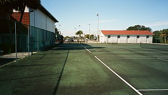 Christopher Columbus High School (Miami-Dade County) - The tennis courts are adjacent to the gymnasium building, at left.
