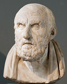 Stone bust of a bearded, grave-looking man