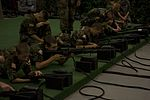 Civil Air Patrol cadets wait for a FATS weapon simulation to begin at Camp Guernsey.jpg