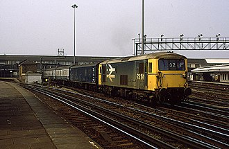 South Western main line - A British Rail Class 73 with a parcels van and carriages heading on the fast lines through Clapham Junction in 1986