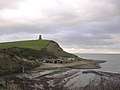 Clavell Tower on Hen Cliff, with the Kimmeridge visitor centre at beach level - geograph.org.uk - 25150.jpg