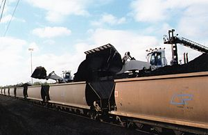 Blackwater railway system - Coal being loaded by front end loaders, Blackwater line