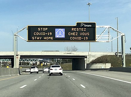 A highway sign on the Highway 417 in Ottawa discouraging non-essential travel