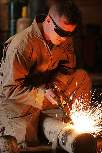 Oxy-fuel welding and cutting - A cutting torch is used to cut a steel pipe.