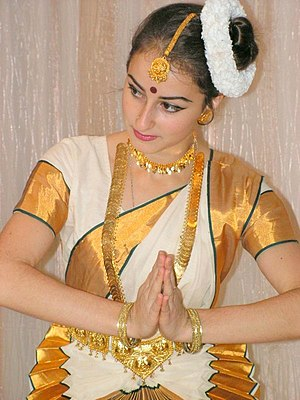 Culture of India - A Mohiniattam dancer making a Namaste gesture.