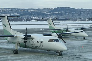 Public service obligation - Two DHC Dash-8-100 aircraft of Widerøe of Norway at Trondheim Airport, Værnes. Widerøe makes a large portion of its revenue from PSO routes like these in Northern and Western Norway