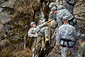 Defense.gov News Photo 110220-A-7341H-041 - U.S. Army Ranger instructors watch as an Army Ranger student rappels down the side of a 60-foot rock face at Camp Frank D. Merrill in Dahlonega.jpg