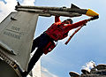 Defense.gov News Photo 110902-N-BT887-329 - U.S. Navy Petty Officer 2nd Class Stephen Bailey caps a missile attached to an F A-18C Hornet aboard the aircraft carrier USS John C. Stennis in.jpg