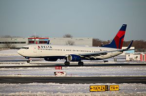 Delta Air Lines - A Delta Air Lines 737-900ER landing at New York JFK Airport.