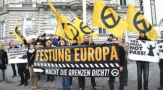 Fortress Europe - Far-right activists at a Identitarian Movement of Austria rally in Vienna on November 10, 2013.
