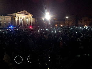 "2014 Hungarian Internet tax protests - A ""candlelight vigil"" with thousands of protesters holding up their phones"