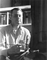 Dickson Reeder seated at easel, facing camera, 1943.jpg