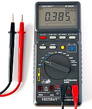 A multimeter set to measure voltage.