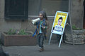 Diminutive performer with fliers and megaphone.jpg