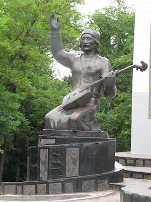 Epic of Jangar - Monument to a Jangarchi (Jangar performer) in Elista