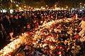 Dozens of mourning people captured during civil service in remembrance of November 2015 Paris attacks victims. Western Europe, France, Paris, place de la République, November 15, 2015.jpg