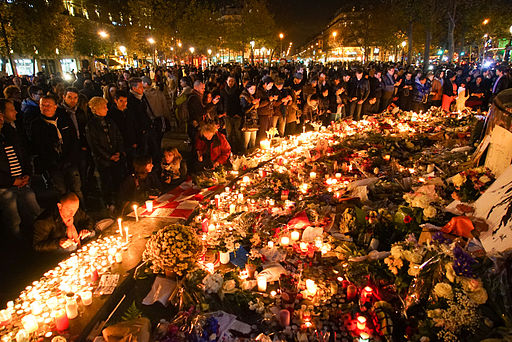 Dozens of mourning people captured during civil service in remembrance of November 2015 Paris attacks victims. Western Europe, France, Paris, place de la République, November 15, 2015