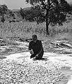 Drying cassava on bare rock.jpg