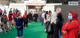 Egyptian women voters have queued according to social distancing procedures in front of one of the polling station